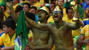 Some camouflaged Brazil supporters cheered on their side as things got underway once more