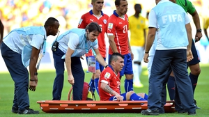 ... who had to be stretchered off during the first period of extra time, with what appeared to be a thigh injury of some sort