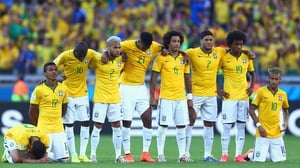 Brazil looked on just before the decisive penalties
