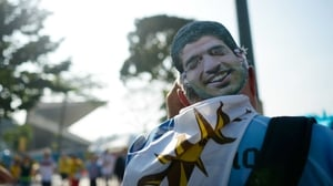A Uruguay supporter sported a mask of disgraced striker Luis Suarez, who was banned for the duration of this World Cup and beyond after allegedly biting an opponent during Uruguay's final Group D match against Italy