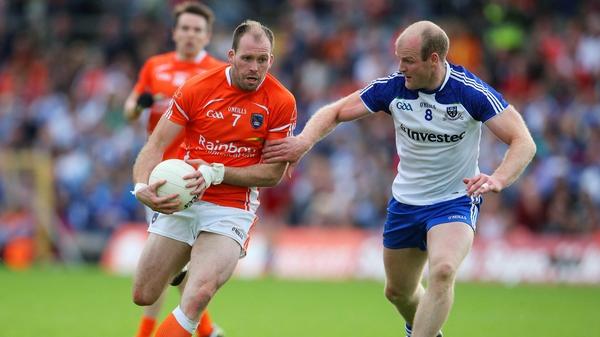 Dick Clerkin of Monaghan tackles Armagh's Ciaran McKeever