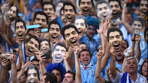 Even though Suarez was watching the match back home in Montevideo, you would never know it by scanning the crowd