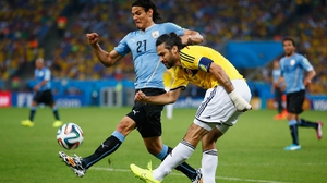 Both sides came out playing ferociously and emotionally. Here, Uruguay forward Edinson Cavani controls the ball against Colombia defender and captain Mario Yepes