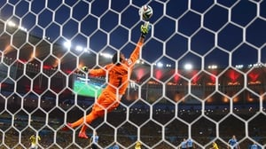 At 28' Colombia's rising star midfielder James Rodriguez handled and rocketed what may be the goal of the tournament so far past Uruguay keeper Fernando Musalera