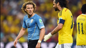 Forlan and Yepes continued to have it out on the pitch