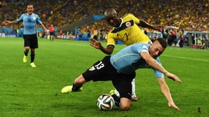 Uruguay defender Jose Gimenez and Colombia defender Pablo Armero battled it out for the ball, trying to allow both of their sides to create some more chances