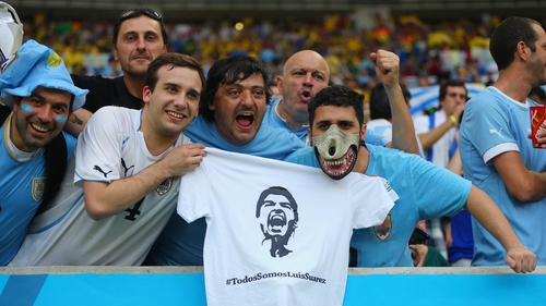 Uruguay fans holds up a t-shirt of Luis Suarez ahead of the 2014 FIFA World Cup Brazil round of 16 match between Colombia and Uruguay