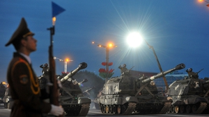 A column of Belarus Army self-propelled howitzers rolls in central Minsk early this morning,  during a rehearsal of a military parade to mark the upcoming Independence Day