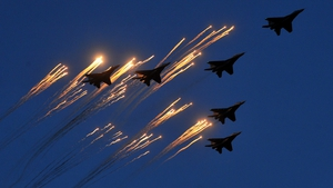 Fighter jets shoot flares while flying over central Minsk