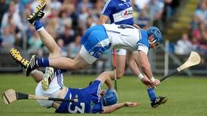 Waterford's Shane Walsh with Brian Campion of Laois take a tumble