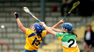 Clare's Claire McMahon and Fiona Stephens of Offaly battle for the sliotar during their championship clash