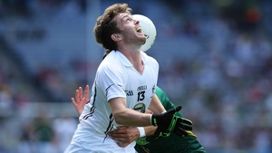 Niall Kelly of Kildare and Donal Keegan Meath lose sight of the ball for a moment