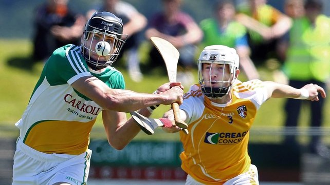 Antrim's Conor McKinley attempts to hook Offaly's Conor Mahon
