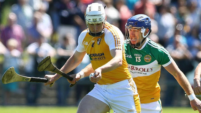 Antrim's Neil McAuley and Brian Carroll of Offaly