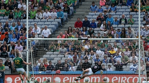 Meath's Andy Tormey scores a penalty past Kildare goalkeeper Mark Donnellan