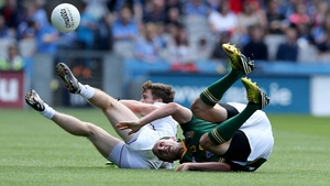 Kildare's Niall Kelly with Kevin Reilly of Meath took a tumble, meanwhile