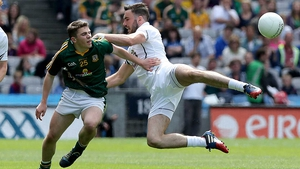 Back in Croker, Kildare's Fergal Conway took to the air in tackling Sean Curran of Meath