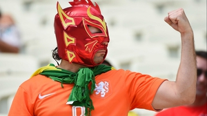 While this Netherlands fan decided to don the signature Mexican wrestling mask