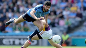 Cian O'Sullivan of Dublin leap-frogs Graeme Molloy of Wexford