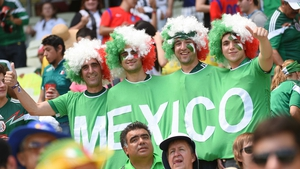 These afro'ed Mexico fans banded together to watch the action