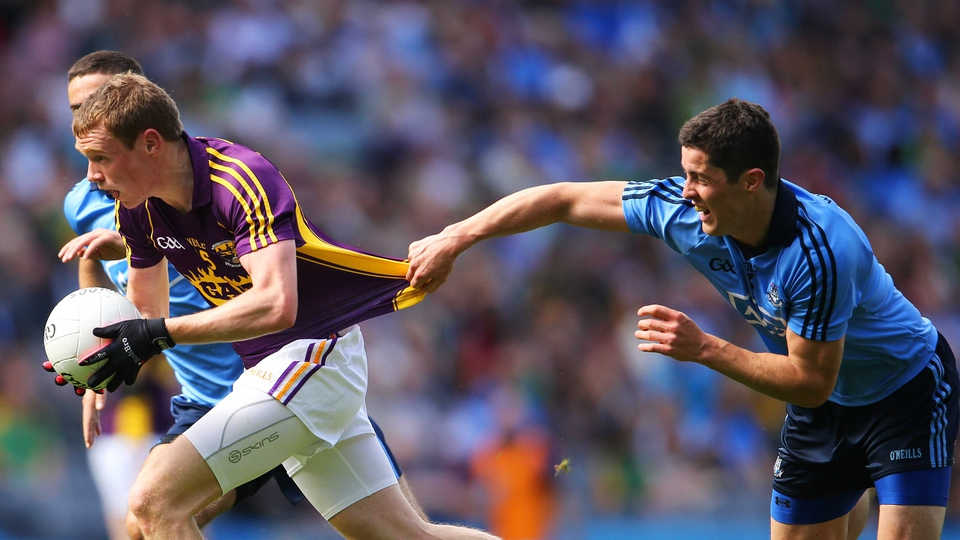 Dublin's Rory O'Carroll seems keen that Kevin O'Grady of Wexford not get too far too fast