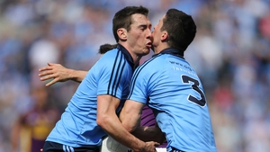 Ouch: Dublin's Nicky Devereux and Rory O'Carroll clash heads while contesting a ball
