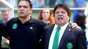 Mexico's boisterous coach Miguel Herrera (R) joined in his country's national anthem