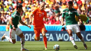 While defenders Hector Moreno and Francisco Rodriguez worked to keep Netherlands star forward Arjen Robben from sneaking a chance early on