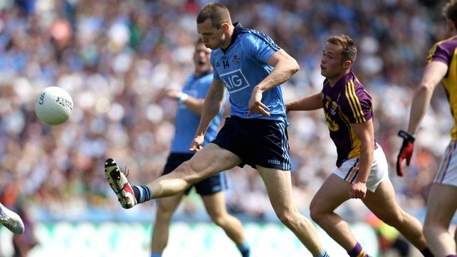 Dublin's Dean Rock under pressure from Conor Carty of Wexford