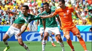 Looking heavy on their feet, Netherlands striker and captain Robin van Persie decided the best way to help his side would be to grab the shirt of Mexico defender and captain Rafael Marquez