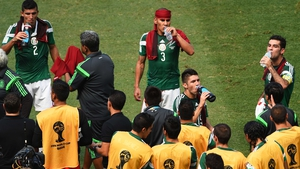 And at 32' the referees called for the first official cooling break of this World Cup. Mexico players used special red towels to cool off on the sidelines