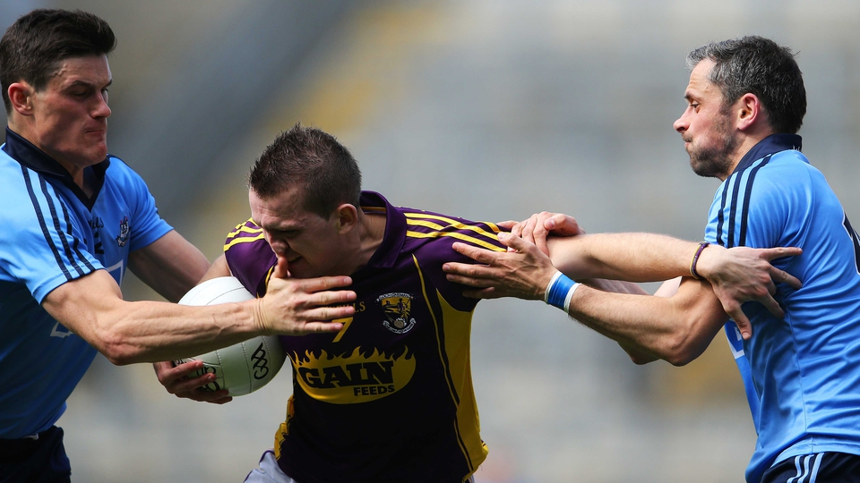 Dublin's tackling was ferocious: Here Wexford's Adrian Flynn comes under under pressure from Diarmuid Connolly and Alan Brogan