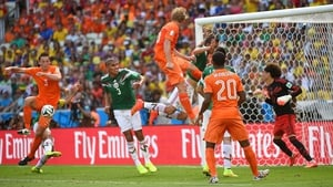 Mexico had more success when Ochoa made a remarkable save midway through the second. The strong shot came off Dutch defender Stefan de Vrij (#3)