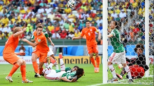 All of the players looked on as the ball sailed away, a promising Dutch chance stopped defiantly by Mexico