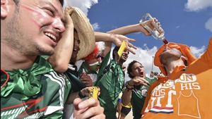 Both Mexico and Netherlands fans were ready to party it up in the sun