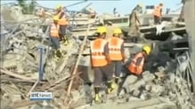 More than 100 workers feared trapped after building collapse in India