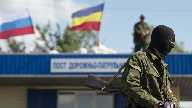 A pro-Russian separatist mans a checkpoint between Donetsk and Luhansk