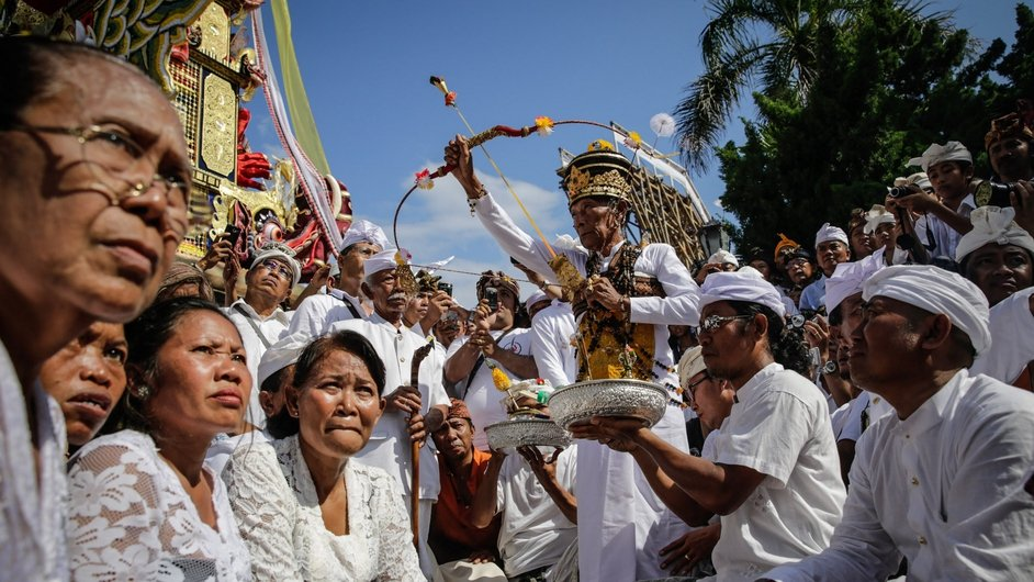 A priest shoots an arrow toward the mighty 'Naga Banda' during the cremation ceremony of empress Ida Dewa Agung Istri Putra in Bali, Indonesia