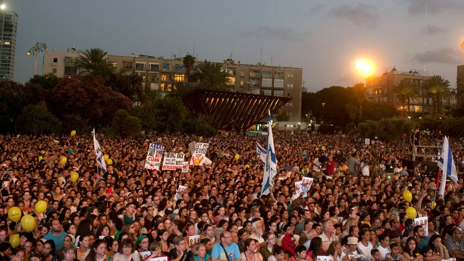 Israelis attend a rally in Tel Aviv, entitled 'Bring Our Boys Home', for three teenagers kidnapped in the West Bank
