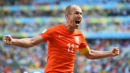 Arjen Robben of the Netherlands celebrates after his team defeated Mexico 2-1 during the 2014 FIFA World Cup