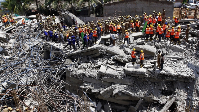 An undetermined number of people remain trapped in the wreckage