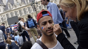 A France fan in Paris, looking ahead to both of the day's fixtures, had the French and Algerian flags painted on his face ahead of watching Le Bleus