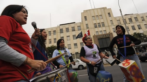 Women shout slogans during a pro-abortion protest in front of the Health Ministry in Lima
