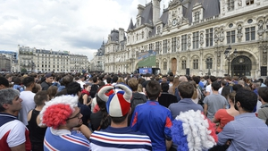 France fans in Paris continued to watch the tight action consumed in concentration