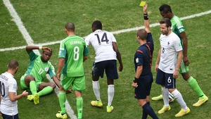 Geiger awarded the match's first yellow card - which should have been a red - to France midfielder Blaise Matuidi (#14) for a vicious ankle tackle made on Nigeria midfielder Ogenyi Onazi