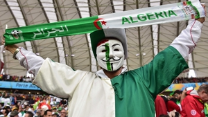 While this Algeria fan - owing to his mask - was never not happy
