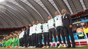 The Algeria bench, headed by coach Vahid Halilhodzic (R) joined in singing their country's national anthem