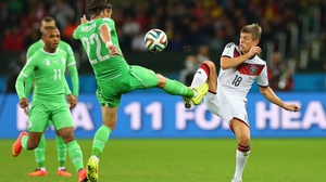 Algeria midfielder Mehdi Mostefa and Germany midfielder Toni Kroos vied for the ball in what continued to be an even contest
