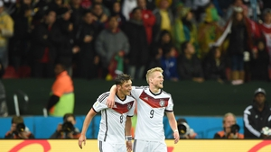 Ozil and Schuerrle joined together in a bit of revelry - almost a bit to quickly