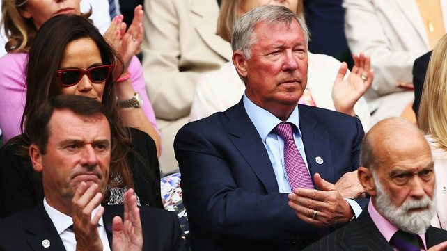 Alex Ferguson watches play from the Royal Box at Wimbledon yesterday